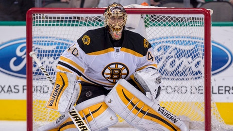 Jan 20, 2015; Dallas, TX, USA; Boston Bruins goalie Tuukka Rask (40) faces the Dallas Stars attack during the third period at the American Airlines Center. The Bruins defeated the Stars 3-1. Rask makes 36 saves and is named number one star of game. Mandatory Credit: Jerome Miron-USA TODAY Sports