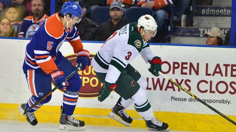Jan 27, 2015; Edmonton, Alberta, CAN; Minnesota Wild center Charlie Coyle (3) skates around Edmonton Oilers defenceman Mark Fayne (5) as he drives to the net in the first period at Rexall Place. Mandatory Credit: Chris LaFrance-USA TODAY Sports