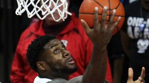 Jan 29, 2015; Piscataway, NJ, USA; Rutgers Scarlet Knights forward D.J. Foreman (22) drives to the basket against Rutgers Scarlet Knights defenders during second half at Louis Brown Athletic Center. Mandatory Credit: Noah K. Murray-USA TODAY Sports
