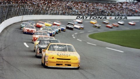 DAYTONA BEACH, FL - FEBRUARY 19, 1995:  Sterling Marlin (#4) leads the pack to the finish line in the 1995 Daytona 500. Marlin beat Dale Earnhardt (#3) to the finish line, again denying Earnhardt a Daytona 500 win.  (Photo by ISC Archives via Getty Images)