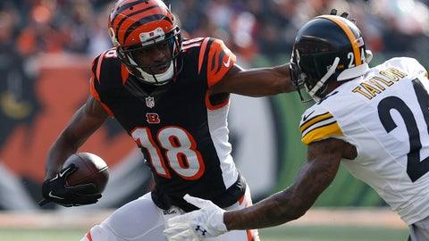 Dec 7, 2014; Cincinnati, OH, USA; Cincinnati Bengals wide receiver A.J. Green (18) stiff arms Pittsburgh Steelers cornerback Ike Taylor (24) at Paul Brown Stadium. The Steelers won 42-21. Mandatory Credit: Aaron Doster-USA TODAY Sports