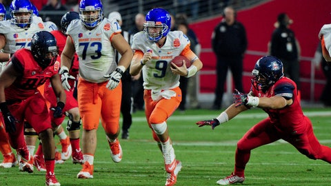 Dec 31, 2014; Glendale, AZ, USA; Boise State Broncos quarterback Grant Hedrick (9) runs with the ball during the first half against the Arizona Wildcats in the 2014 Fiesta Bowl at Phoenix Stadium. Mandatory Credit: Matt Kartozian-USA TODAY Sports