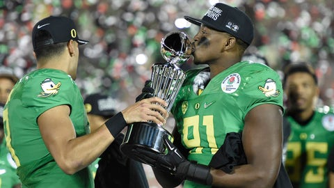 Jan 1, 2015; Pasadena, CA, USA; Oregon Ducks quarterback Marcus Mariota (8) and linebacker Tony Washington (91) celebrate with the Leishman Trophy after defeating the Florida State Seminoles in the 2015 Rose Bowl college football game at Rose Bowl. Mandatory Credit: Gary Vasquez-USA TODAY Sports