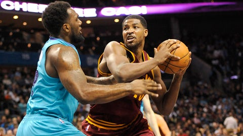 Jan 2, 2015; Charlotte, NC, USA; Cleveland Cavaliers forward Tristan Thompson (13) attempts to pass the ball as he is defended by Charlotte Hornets guard P.J. Hairston (19) during the first half of the game at Time Warner Cable Arena. Mandatory Credit: Sam Sharpe-USA TODAY Sports