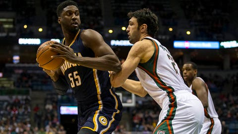 Jan 2, 2015; Milwaukee, WI, USA; Indiana Pacers center Roy Hibbert (55) looks to shoot against Milwaukee Bucks center Zaza Pachulia (27) during the third quarter at BMO Harris Bradley Center. Mandatory Credit: Jeff Hanisch-USA TODAY Sports