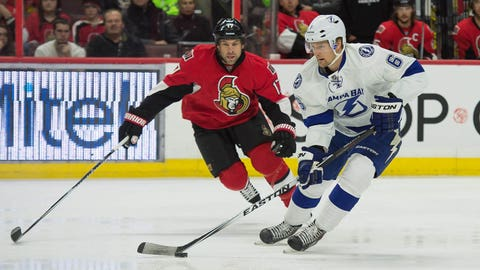 Jan 4, 2015; Ottawa, Ontario, CAN; Tampa Bay Lightning defenseman Anton Stralman (6) skates with the puck in front of Ottawa Senators center David Legwand (17) in the first period at the Canadian Tire Centre. Mandatory Credit: Marc DesRosiers-USA TODAY Sports