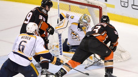 Jan 4, 2015; Anaheim, CA, USA; Anaheim Ducks defenseman Francois Beauchemin (23) scores the game tying goal on Nashville Predators goalie Carter Hutton (30) to force overtime during the third period at Honda Center. The Anaheim Ducks won in a shootout with a score of 4-3. Mandatory Credit: Kelvin Kuo-USA TODAY Sports