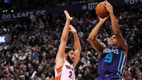 Jan 8, 2015; Toronto, Ontario, CAN; Charlotte Hornets guard Gerald Henderson (9) shoots as Toronto Raptors guard Greivis Vasquez (21) attempts to block the shot in the second quarter at Air Canada Centre. Mandatory Credit: Peter Llewellyn-USA TODAY Sports