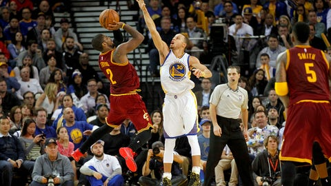 Jan 9, 2015; Oakland, CA, USA; Cleveland Cavaliers guard Kyrie Irving (2) attempts a shot over Golden State Warriors guard Stephen Curry (30) in the third quarter at Oracle Arena. The Warriors defeated the Cavaliers 112-94. Mandatory Credit: Cary Edmondson-USA TODAY Sports