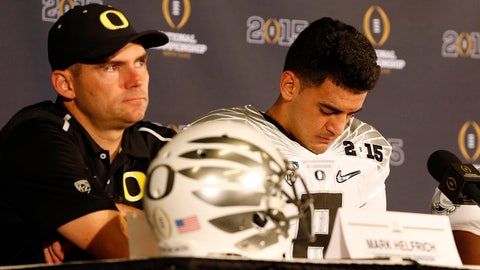 Jan 12, 2015; Arlington, TX, USA; Oregon Ducks quarterback Marcus Mariota (8) reacts during a press conference after losing to the Ohio State Buckeyes in the 2015 CFP National Championship Game at AT&T Stadium. Mandatory Credit: Tim Heitman-USA TODAY Sports