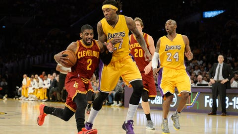 Jan 15, 2015; Los Angeles, CA, USA; Cleveland Cavaliers guard Kyrie Irving (2) drives to the basket against Los Angeles Lakers center Jordan Hill (27) in the first half during the NBA game at Staples Center. Mandatory Credit: Richard Mackson-USA TODAY Sports