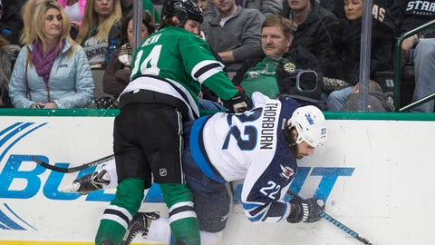 Jan 15, 2015; Dallas, TX, USA; Dallas Stars defenseman Jordie Benn (24) checks Winnipeg Jets right wing Chris Thorburn (22) during the third period at the American Airlines Center. The Jets defeated the Stars 2-1. Mandatory Credit: Jerome Miron-USA TODAY Sports
