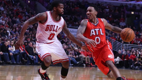 Jan 17, 2015; Chicago, IL, USA; Atlanta Hawks guard Jeff Teague (0) drives past Chicago Bulls guard Aaron Brooks (0) during the second quarter at the United Center. Mandatory Credit: Dennis Wierzbicki-USA TODAY Sports