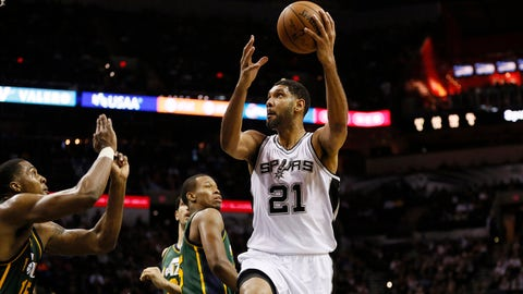 Jan 18, 2015; San Antonio, TX, USA; San Antonio Spurs power forward Tim Duncan (21) shoots the ball during the second half against the Utah Jazz at AT&T Center. The Spurs won 89-69. Mandatory Credit: Soobum Im-USA TODAY Sports