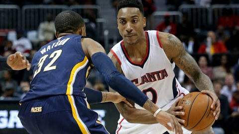 Jan 21, 2015; Atlanta, GA, USA; Atlanta Hawks guard Jeff Teague (0) makes a move on Indiana Pacers guard C.J. Watson (32) in the first quarter of their game at Philips Arena. The Hawks won 110- 91. Mandatory Credit: Jason Getz-USA TODAY Sports
