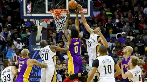 Jan 21, 2015; New Orleans, LA, USA; New Orleans Pelicans forward Anthony Davis (23) blocks a shot by Los Angeles Lakers forward Nick Young (0) during the second half of a game at the Smoothie King Center. The Pelicans defeated the Lakers 96-80. Mandatory Credit: Derick E. Hingle-USA TODAY Sports