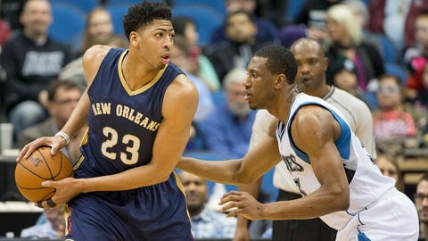 Jan 23, 2015; Minneapolis, MN, USA; New Orleans Pelicans forward Anthony Davis (23) looks to the basket past Minnesota Timberwolves forward Thaddeus Young (33) in the first half at Target Center. Mandatory Credit: Jesse Johnson-USA TODAY Sports