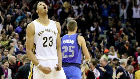 Jan 25, 2015; New Orleans, LA, USA; New Orleans Pelicans forward Anthony Davis (23) celebrates a win as Dallas Mavericks forward Chandler Parsons (25) walks off the court following a game at the Smoothie King Center. The Pelicans defeated the Mavericks 109-106.  Mandatory Credit: Derick E. Hingle-USA TODAY Sports