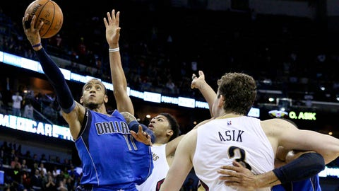 Jan 25, 2015; New Orleans, LA, USA; Dallas Mavericks guard Monta Ellis (11) shoots over New Orleans Pelicans forward Anthony Davis (23) during the fourth quarter of a game at the Smoothie King Center. The Pelicans defeated the Mavericks 109-106.  Mandatory Credit: Derick E. Hingle-USA TODAY Sports
