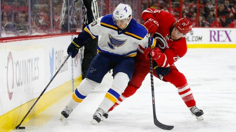 Jan 30, 2015; Raleigh, NC, USA; St. Louis Blues left wing Joakim Lindstrom (10) moves the puck against Carolina Hurricanes left wing Chris Terry (25) at PNC Arena. Mandatory Credit: James Guillory-USA TODAY Sports