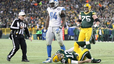 GREEN BAY, WI - DECEMBER 28:  Defensive end Ezekiel Ansah #94 of the Detroit Lions stands over quarterback Aaron Rodgers #12 of the Green Bay Packers as he holds his leg in the second quarter during the NFL game at Lambeau Field on December 28, 2014 in Green Bay, Wisconsin.  (Photo by Mike McGinnis/Getty Images)