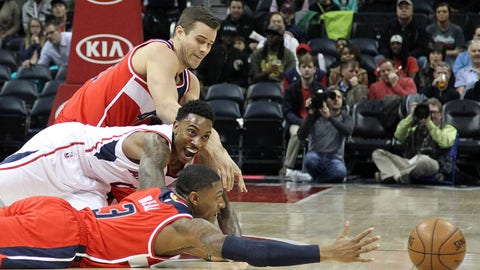 Jan 11, 2015; Atlanta, GA, USA; Atlanta Hawks guard Jeff Teague (0) and Washington Wizards forward Kris Humphries (43) and guard Bradley Beal (3) dives for a loose ball in the first quarter at Philips Arena. Mandatory Credit: Brett Davis-USA TODAY Sports
