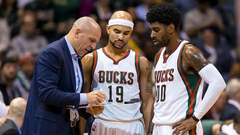Jan 19, 2015; Milwaukee, WI, USA; Milwaukee Bucks head coach Jason Kidd talks with guards Jerryd Bayless (19) and O.J. Mayo (00) during the fourth quarter against the Toronto Raptors at BMO Harris Bradley Center.  Toronto won 92-89.  Mandatory Credit: Jeff Hanisch-USA TODAY Sports