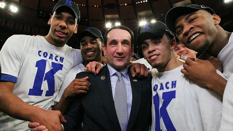 NEW YORK, NY - JANUARY 25:  Head coach Mike Krzyzewski of the Duke Blue Devils celebrates with teamates after his 1000th career win after the game against the St. John's Red Storm at Madison Square Garden on January 25, 2015 in New York City.  (Photo by Nate Shron/Getty Images)
