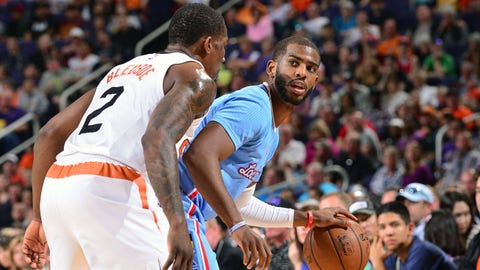 PHOENIX, AZ - JANUARY 25:  Chris Paul #3 of the Los Angeles Clippers handles the ball against the Phoenix Suns during the game on January 25, 2015 at U.S. Airways Center in Phoenix, Arizona. NOTE TO USER: User expressly acknowledges and agrees that, by downloading and or using this photograph, user is consenting to the terms and conditions of the Getty Images License Agreement. Mandatory Copyright Notice: Copyright 2015 NBAE (Photo by Barry Gossage/NBAE via Getty Images)