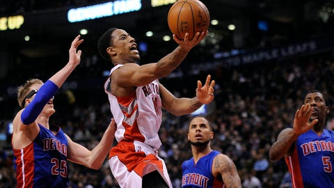 Jan 25, 2015; Toronto, Ontario, CAN; Toronto Raptors guard DeMar DeRozan (10) jumps to score two as Detroit Pistons forward Kyle Singler (25) defends in the third quarter at Air Canada Centre. Mandatory Credit: Peter Llewellyn-USA TODAY Sports