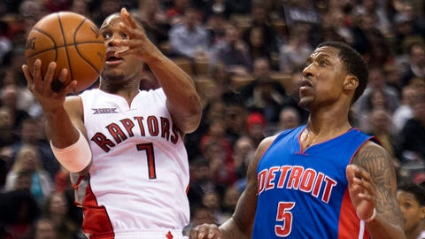 Toronto Raptors guard Kyle Lowry (7) drives past Detroit Pistons guard Kentavious Caldwell-Pope (5) during first half NBA basketball action in Toronto on Sunday, Jan. 25, 2015. (AP Photo/The Canadian Press, Nathan Denette)