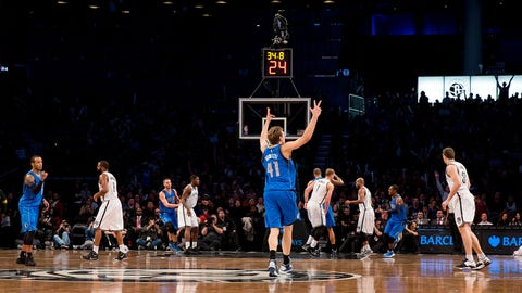 BROOKLYN, NY - JANUARY 5:  Dirk Nowitzki #41 of the Dallas Mavericks celebrates moving into 7th place on the NBA all time scoring list during the game against the Brooklyn Nets on January 5, 2015 at Barclays Center in Brooklyn, New York. NOTE TO USER: User expressly acknowledges and agrees that, by downloading and or using this Photograph, user is consenting to the terms and conditions of the Getty Images License Agreement. Mandatory Copyright Notice: Copyright 2015 NBAE (Photo by Reid Kelley/NBAE via Getty Images)