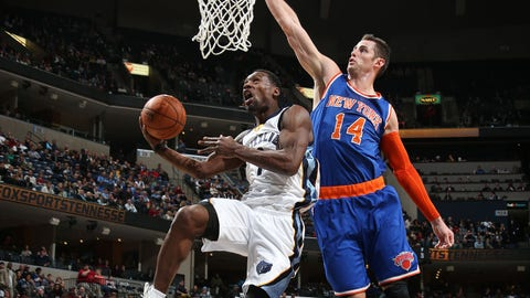 MEMPHIS, TN - JANUARY 5:  Tony Allen #9 of the Memphis Grizzlies goes to the basket against Jason Smith #14 of the New York Knicks on January 5, 2015 at the FedExForum in Memphis, Tennessee.  NOTE TO USER: User expressly acknowledges and agrees that, by downloading and or using this Photograph, user is consenting to the terms and conditions of the Getty Images License Agreement. Mandatory Copyright Notice: Copyright 2015 NBAE (Photo by Joe Murphy/NBAE via Getty Images)