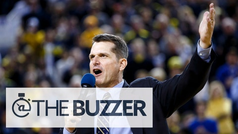 Dec 30, 2014; Ann Arbor, MI, USA; Michigan Wolverines head football coach Jim Harbaugh address the crowd during halftime of the game against the Illinois Fighting Illini at Crisler Center. Mandatory Credit: Rick Osentoski-USA TODAY Sports