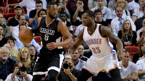Jan 20, 2015; Miami, FL, USA; Miami Heat guard Dwyane Wade (3) is pressured by Oklahoma City Thunder guard Dion Waiters (23) during the first half at American Airlines Arena. Mandatory Credit: Steve Mitchell-USA TODAY Sports