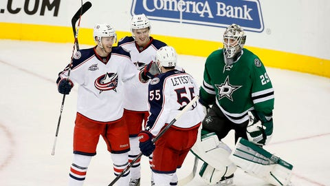 Columbus Blue Jackets' Sean Collins (37), Alexander Wennberg (41) of Sweden and Mark Letestu (55) celebrate a goal by Letestu against Dallas Stars' Anders Lindback (29) of Sweden late in the third period of an NHL hockey game, Tuesday, Jan. 6, 2015, in Dallas. The score helped the Blue Jackets to the 4-2 win over the Stars. (AP Photo/Tony Gutierrez)
