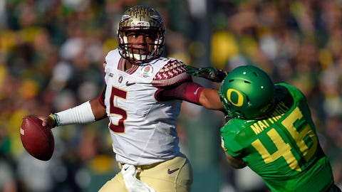 Florida State quarterback Jameis Winston, left, looks to pass under pressure from Oregon linebacker Danny Mattingly during the first half of the Rose Bowl NCAA college football playoff semifinal, Thursday, Jan. 1, 2015, in Pasadena, Calif. (AP Photo/Mark J. Terrill)