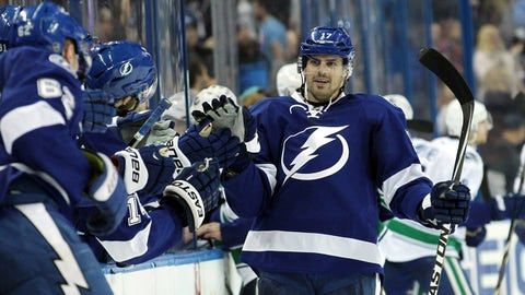 Jan 20, 2015; Tampa, FL, USA; Tampa Bay Lightning center Alex Killorn (17) is congratulated after he scored a goal against the Vancouver Canucks during the third period at Amalie Arena. Tampa Bay Lightning defeated the Vancouver Canucks 4-1. Mandatory Credit: Kim Klement-USA TODAY Sports