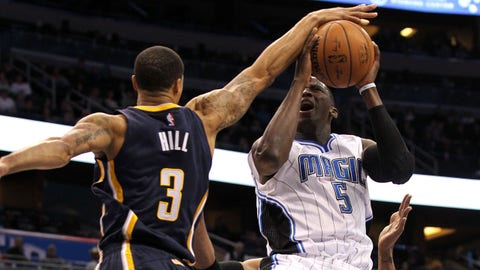 Jan 25, 2015; Orlando, FL, USA; Indiana Pacers guard George Hill (3) blocks the shot of Orlando Magic guard Victor Oladipo (5) during the first quarter at Amway Center. Mandatory Credit: Kim Klement-USA TODAY Sports