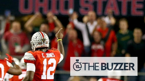 ARLINGTON, TX - JANUARY 12:  Quarterback Cardale Jones #12 celebrates as running back Ezekiel Elliott #15 of the Ohio State Buckeyes scores a 33 yard touchdown in the first quarter against the Oregon Ducks during the College Football Playoff National Championship Game at AT&T Stadium on January 12, 2015 in Arlington, Texas.  (Photo by Ronald Martinez/Getty Images)
