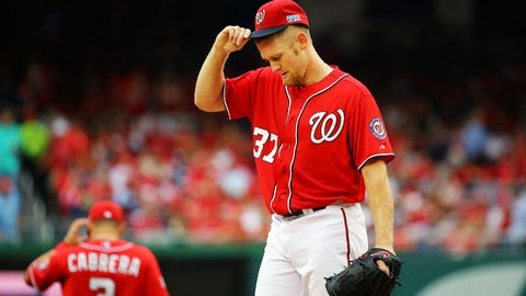 WASHINGTON, DC - OCTOBER 03:  Stephen Strasburg #37 of the Washington Nationals reacts after Hunter Pence #8 of the San Francisco Giants scored in the fourth inning during Game One of the National League Division Series at Nationals Park on October 3, 2014 in Washington, DC.  (Photo by Al Bello/Getty Images)