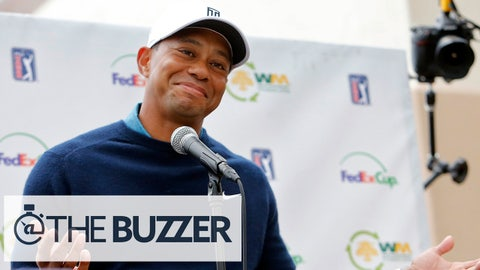 Tiger Woods gestures as he talks to the media after playing a practice round at the Phoenix Open golf tournament, Tuesday, Jan. 27, 2015, in Scottsdale, Ariz. (AP Photo/Rick Scuteri)