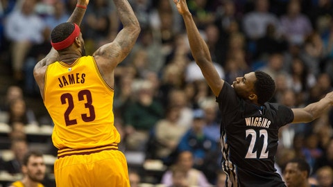 Jan 31, 2015; Minneapolis, MN, USA; Cleveland Cavaliers forward LeBron James (23) shoots over Minnesota Timberwolves guard Andrew Wiggins (22) during the fourth quarter at Target Center. The Cavaliers defeated the Timberwolves 106-90. Mandatory Credit: Brace Hemmelgarn-USA TODAY Sports