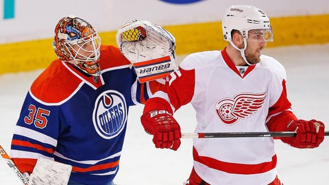 Jan 6, 2015; Edmonton, Alberta, CAN;  Detroit Red Wings forward Riley Sheahan (15) tries to screen Edmonton Oilers goaltender Viktor Fasth (35) during the first period at Rexall Place. Mandatory Credit: Perry Nelson-USA TODAY Sports