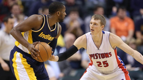 Feb 4, 2015; Indianapolis, IN, USA; Indiana Pacers guard C.J. Miles (0) is guarded by Detroit Pistons forward Kyle Singler (25) at Bankers Life Fieldhouse. Mandatory Credit: Brian Spurlock-USA TODAY Sports