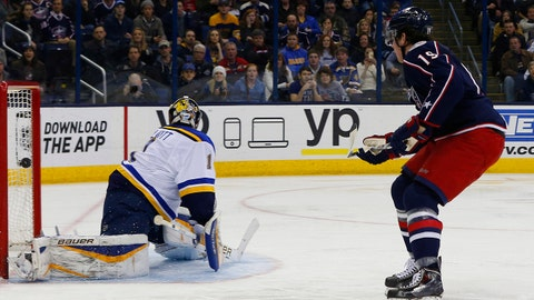 Feb 6, 2015; Columbus, OH, USA; Columbus Blue Jackets center Ryan Johansen (19) scores against St Louis Blues goalie Brian Elliott (1) during the second period at Nationwide Arena. Mandatory Credit: Russell LaBounty-USA TODAY Sports
