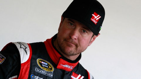 DAYTONA BEACH, FL - FEBRUARY 14:  Kurt Busch, driver of the #41 Haas Automation Chevrolet, stands in the garage area during practice for the 57th Annual Daytona 500 at Daytona International Speedway on February 14, 2015 in Daytona Beach, Florida.  (Photo by Brian Lawdermilk/Getty Images)