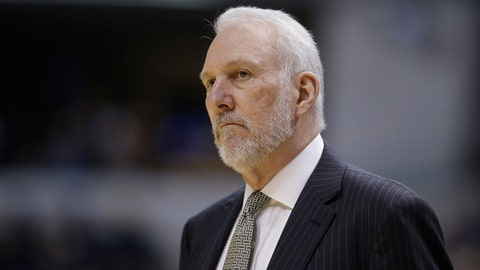 San Antonio Spurs head coach Gregg Popovich watches during the first half of an NBA basketball game against the Indiana Pacers, Monday, Feb. 9, 2015, in Indianapolis. (AP Photo/Darron Cummings)