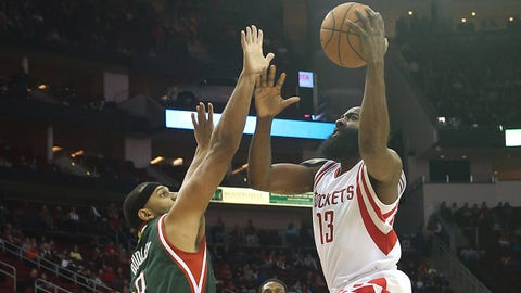 Feb 6, 2015; Houston, TX, USA; Houston Rockets guard James Harden (13) lays the ball up against Milwaukee Bucks guard Jared Dudley (9) in the first quarter at Toyota Center. Mandatory Credit: Thomas B. Shea-USA TODAY Sports