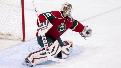 Feb 7, 2015; Saint Paul, MN, USA; Minnesota Wild goalie Devan Dubnyk makes a save in the third period against the Colorado Avalanche at Xcel Energy Center. The Minnesota Wild beat the Colorado Avalanche 1-0. Mandatory Credit: Brad Rempel-USA TODAY Sports